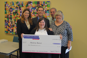 Moira Rossi was awarded a $1,000 check for her YouTube video about achieving her American dream