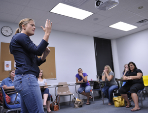 A UNF student shows off her ASL skills (Photo by Nick Uselman).