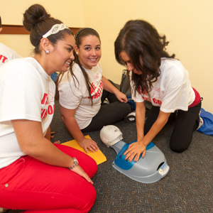 UNF students practice their hands-only CPR technique (Photo by Dennis Ho).