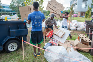 Sudent volunteers properly dispose of recycling that was previously headed to a landfill (Photo by Dennis Ho).