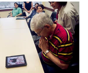 Hurst's coworkers assembled to look at pictures and reminisce about their friend and colleague. (Photo by Dennis Ho)