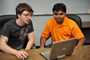 Students Erick Douglas and Nihar Goswami demonstrate the functionality of the Osprey Flight Path. (Photo by Dennis Ho)