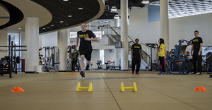 Wayant takes on the shuttle run challenge as his fellow trainers look on (Photo by Katerina Turner).