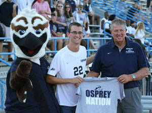 Student Body President Carlo Fassi and AD Lee Moon pose with Ozzie during UNF Athletics outing