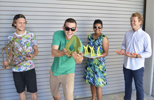 The UNF sculpture students who designed the bike racks pose with the models of the their work (Photo by Matt Coleman).