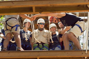 A group of UNF student employees work together on the Osprey Challenge Course