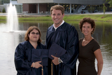 Recent graduates Rose Mueller and Matthew Robin, with Lynn Brown (right)