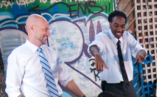 Dr. Chris Janson and Travis Pinckney enjoy a hip-hop performance by a group of Paxon Middle School students.