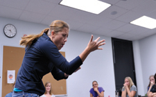 ASL students learn to use exaggerated facial expressions as part of their