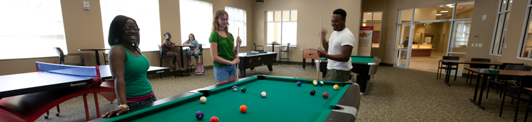 Student play billiards in Osprey Fountains