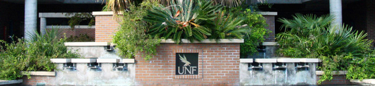 Plaque of the UNF logo above a fountain
