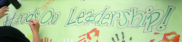 Painted banner says Hands On Leadership