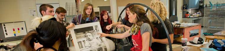 Art students participate in critique session for a print