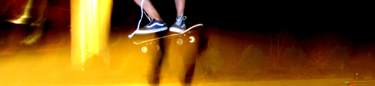 Image of skateboarder's feet with long-exposure lights