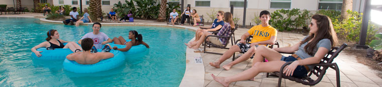 Students relax at the Osprey Fountains pool