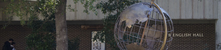 Metal sculpture of globe in front of English Hall