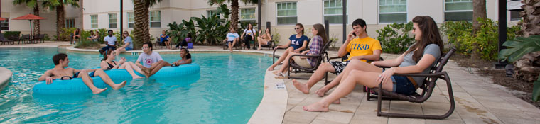 Students enjoy the pool at Osprey Fountains