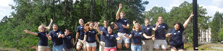 Orientation leaders jump in the air in excitement