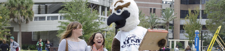 Mascot Ozzie with students on campus