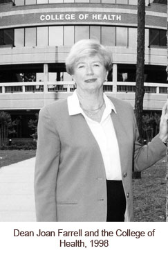 Dean Joan Farrell in front College of Health
