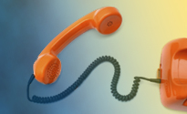 Orange telephone receiver and cord