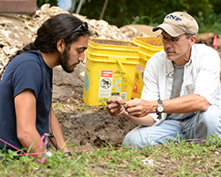 Faculty and Student at a dig