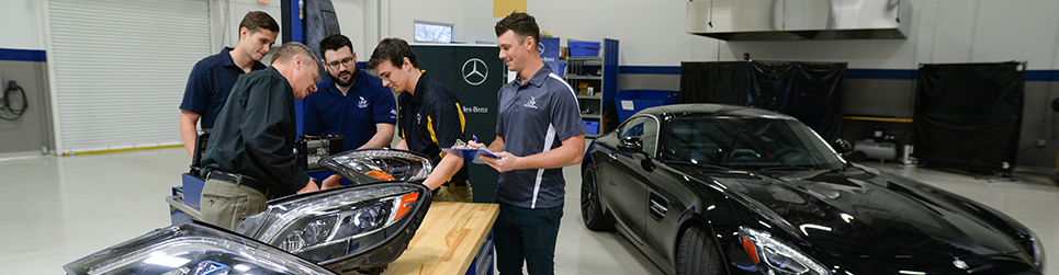 engineering students working on a project at Mercedes