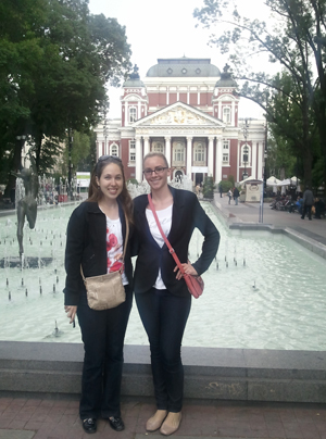 Brenna Bagrow (right) and a colleague in front of a government building in Bulgaria (Photo submitted).
