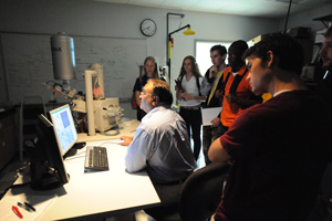 Dr. Nirmal Patel shows students some of his research during a recent Jumpstart Experience visit to the UNF Physics Department (Photo by Jennifer Grissom).