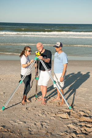 Resio (middle) and a few coastal engineering students at work during a transformational-learning opportunity at the beach (Photo by Jennifer Grissom).
