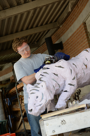 Kyle Newsome prepares his tiger installation for ZOOLights display (Photos by Jennifer Grissom).