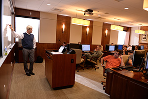 Dr. David Swanson walks his students through a lesson in the UNF LITSLAB.
