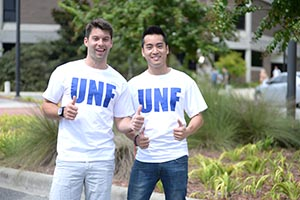 A photo of two UNF students wearing University T-shirts (photo by Jennifer Grissom)