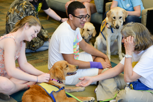 Student lined up to get a chance to spend some time with the CCI dogs (photo by Jennifer Grissom).