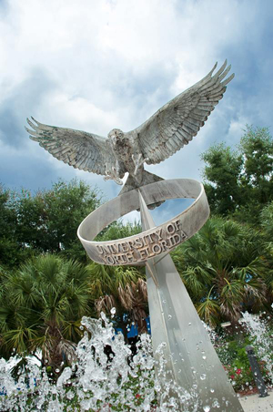A photo of UNF's iconic osprey fountain near the Arena