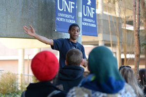 A member of the UNF Swoop Squad takes prospective students on a tour of campus, including the residence halls.