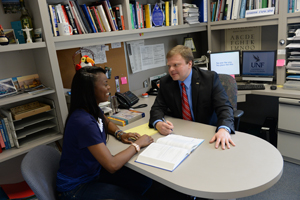 Dr. Kostin (right) works with a student in his office (Photos by Jennifer Grissom).