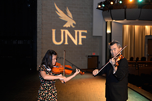 Angel performs in the Lazzara Theater with Dr. Simon Shiao (photos by Jennifer Grissom)