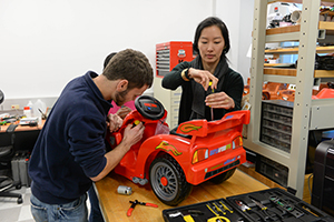 A photo of students working on one of the adaptive toys (Photo by Jennifer Grissom)