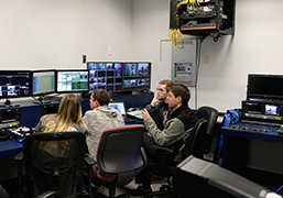 A photo of UNF students working in the new studio