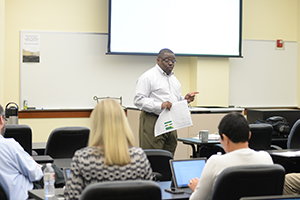 Brinson working with his new staff during a recent meeting