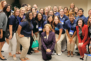 Dr. Carolyn Stone (kneeling) helped organize the White House Convening at UNF