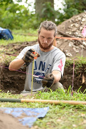 A student works on the excavation of the site