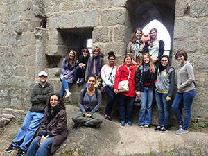 Shira Schwam Baird (bottom right) poses with students during the most recent study-abroad trip to France.