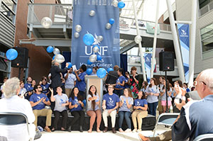 Honors students release balloons after the announcement of the Hicks Honors College at UNF