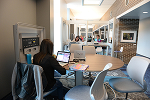 A photo of UNF students using the new Library Commons work spaces
