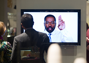 MOCA guests watch a video featuring Al Letson