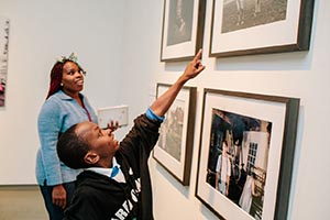 A student from an area school points at a piece of art from MOCA's permanent collection