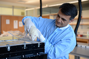 Dr. Alireza Jahan-mihan holding a rat test subject