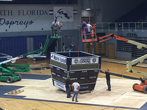 The UNF Arena's old scoreboard comes down